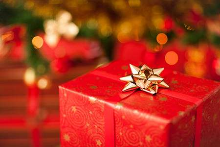 gift wrapped in red wrapping paper with gold bow