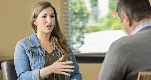 Young female talking to male therapist