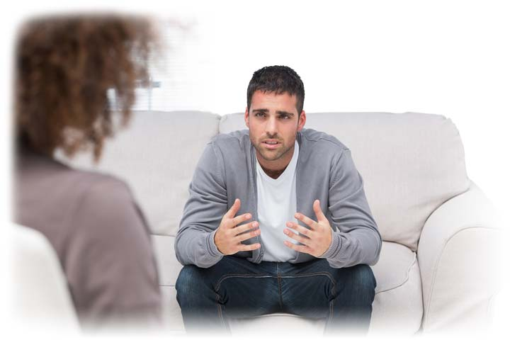 man talking to therapist on a couch